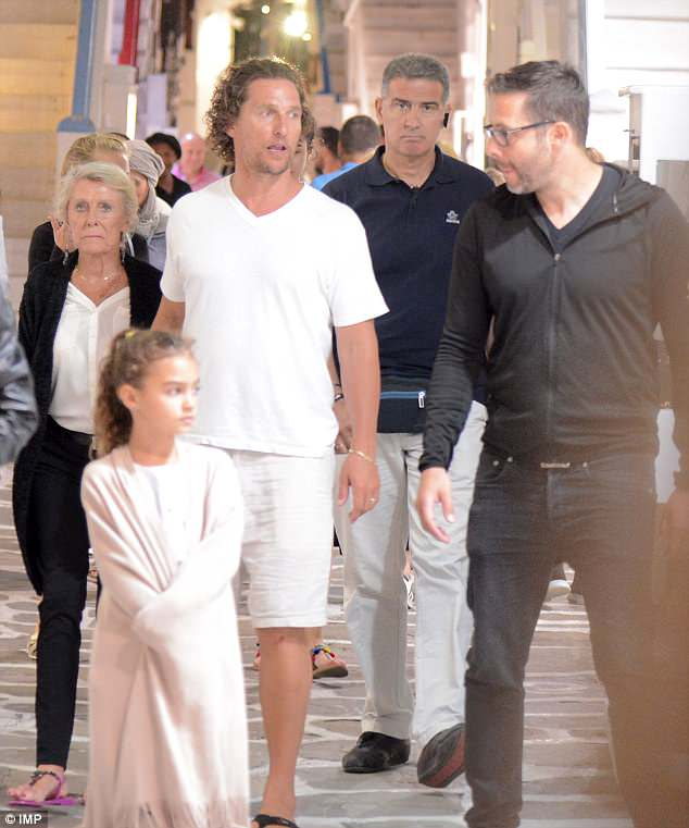Out and about: The 48-year-old, his Brazilian wife Camila, 36, and two of their three children enjoyed the warm evening as they  strolled around Mykonos town. Hi as well as his beloved mother Mary McCabe is seen far left