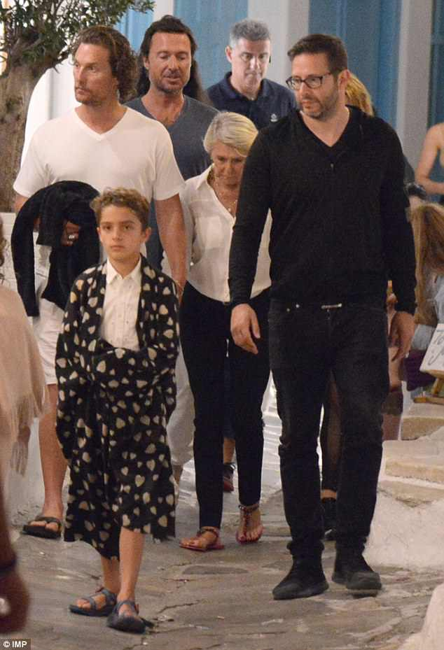 Intrepid lad: Nine-year-old Levi lead the way through Mykonos town with a blanket draped around his shoulders