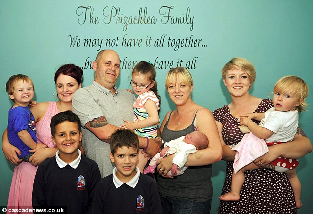 The Phizacklea family including mother Amanda (centre right) with with newborn Eva and (l-r) Sam, 2, Rebecca, 19, Ben, 9, father Steve  with Lexi, 4, Jack, 7, and Lyndsey, 20, with her own daughter Elizabeth, 18 months