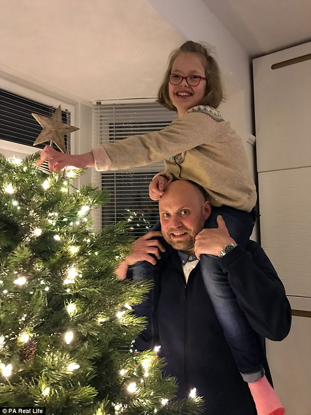 Scott with his daughter Molly enjoying the festive season despite their family struggles