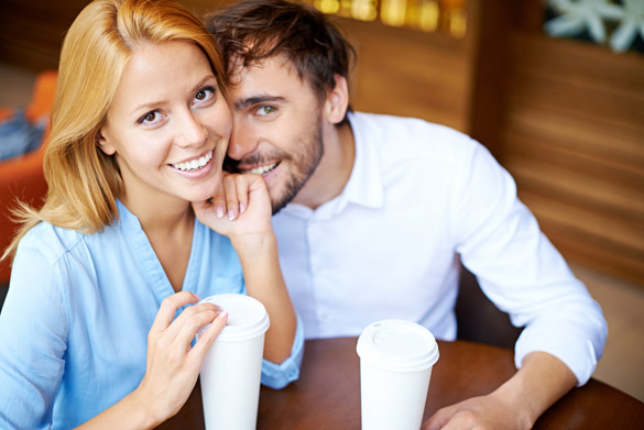 Portrait of young couple sitting by table in cafe - What a Scorpio Man Does To Show You He Loves You